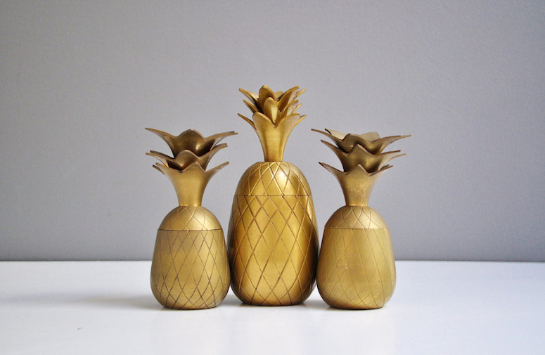 Vintage brass pineapple containers and mirror via The White Pepper Etsy