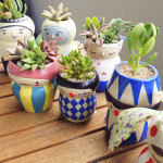 Adorable Face Pots to Brighten Your Day by Polkaros