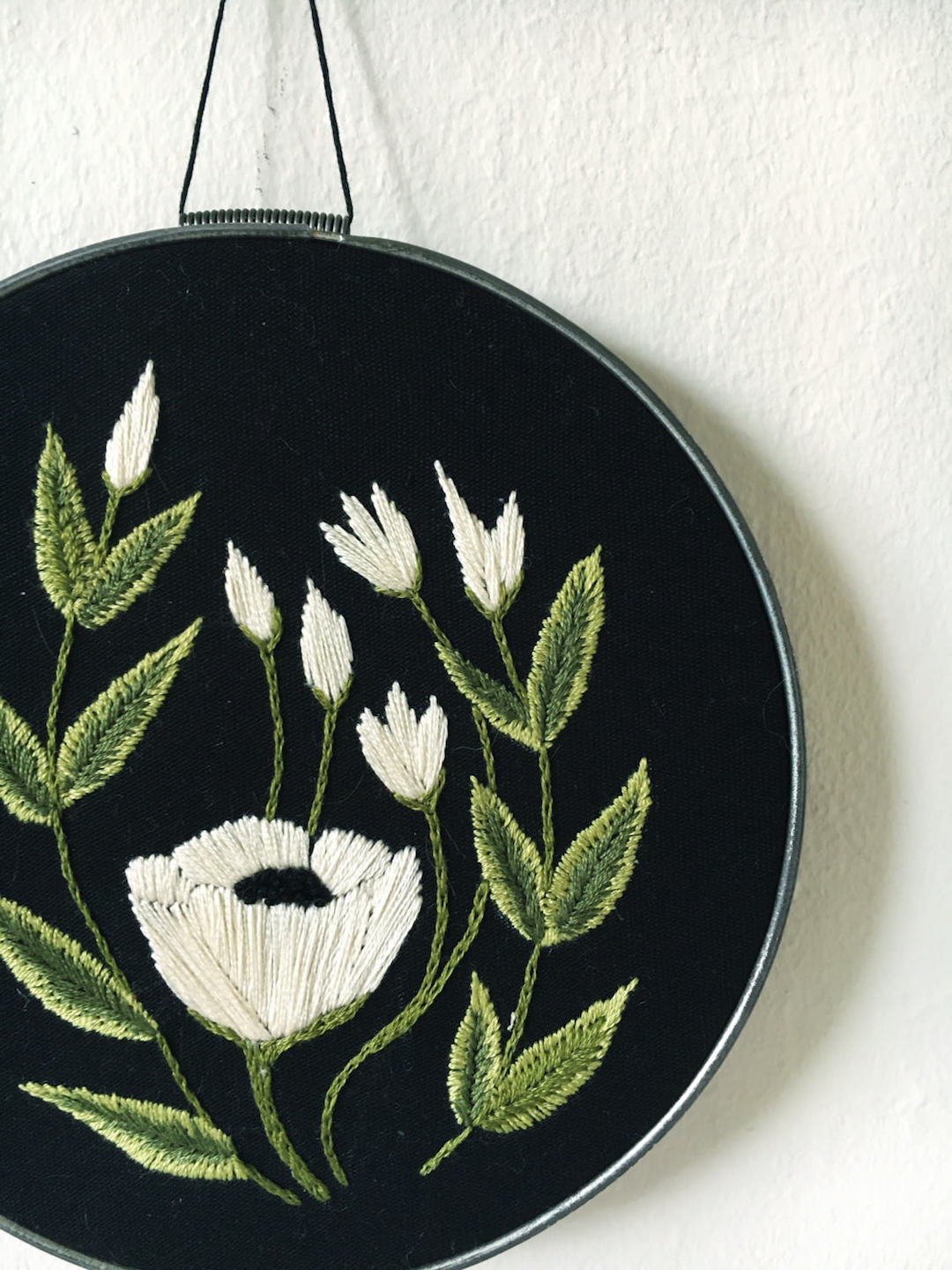 Embroidered hoop art by Tusk and Cardinal