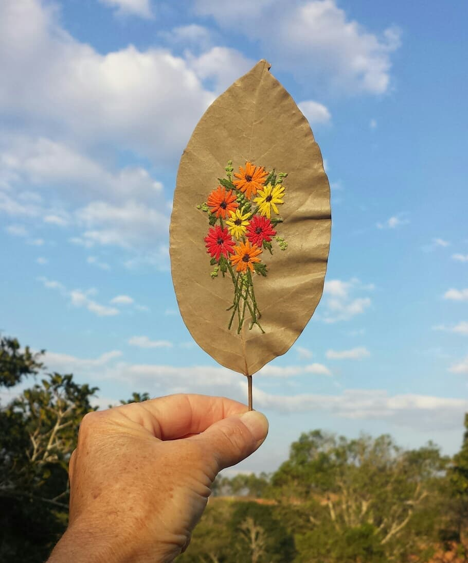 Embroidery on a leaf by Solange Nunes