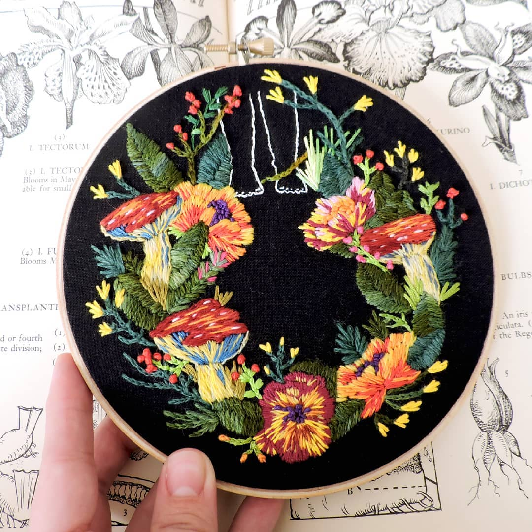 Embroidery on black fabric by Claudia González