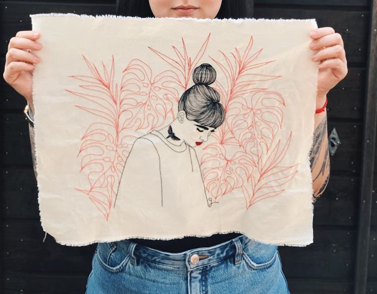 Hand-stitched hoop art by Giselle Quinto