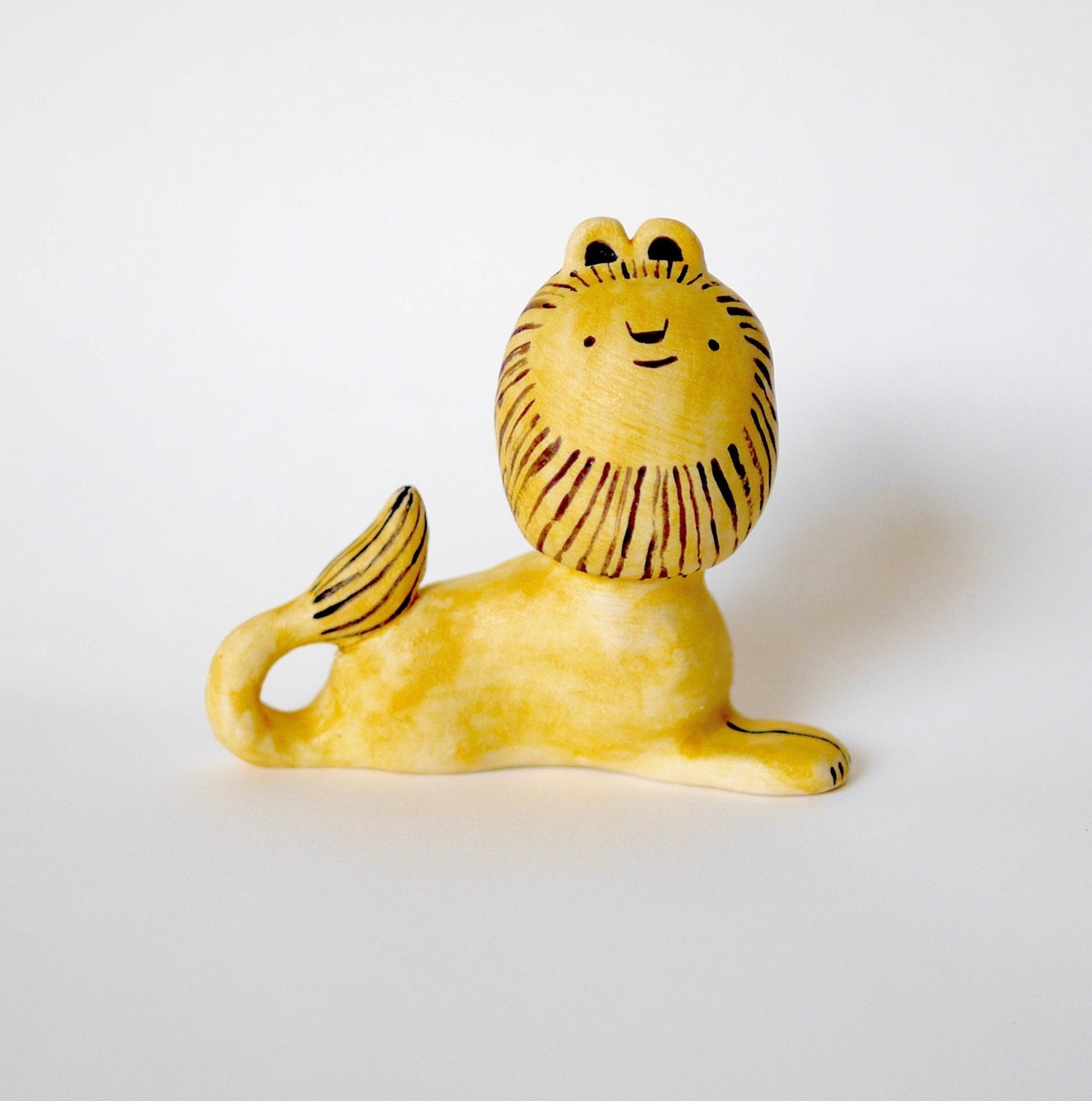 Lion ceramic figurine