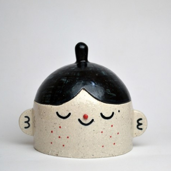 Happy face ceramic jar