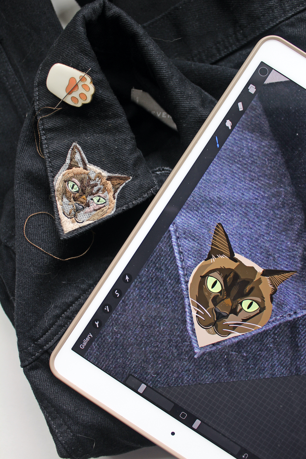 Cat embroidery accompanied by a digital sketch on an iPad