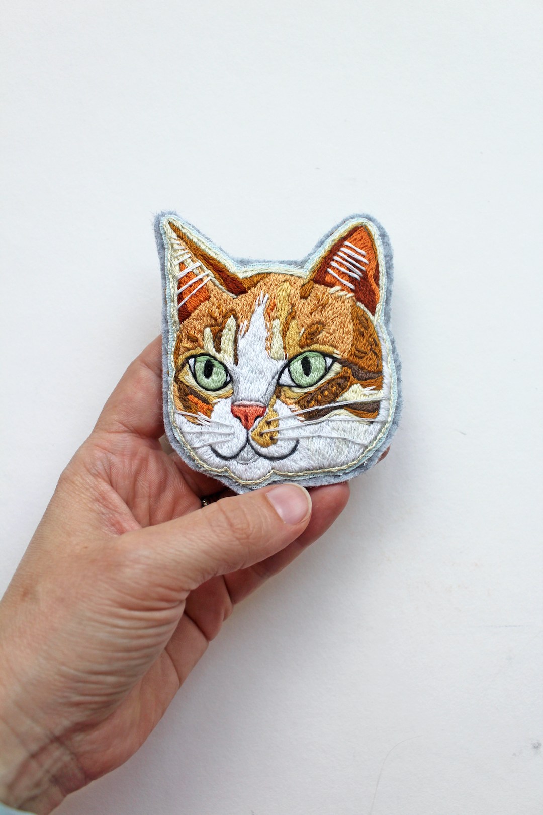 Custom embroidered patch of a cat