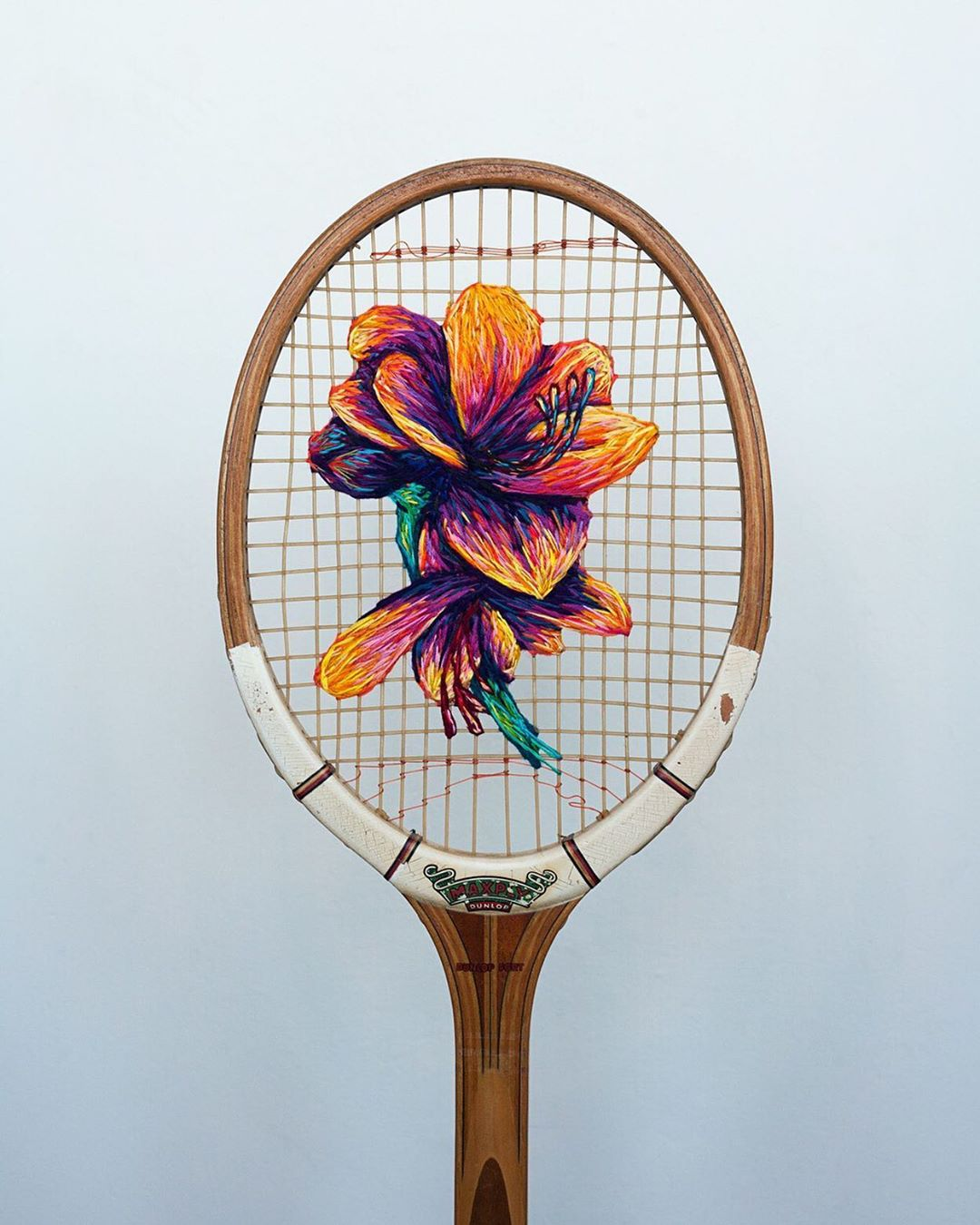 Colorful Embroideries on Discarded Tennis Rackets Are Serving Beautiful Blooms