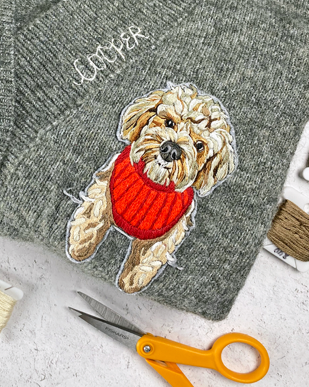 Custom pet portrait on sweater by Brown Paper Stitch